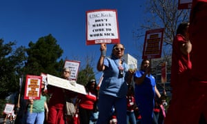 Caregivers and nurses protest changes to their sick leave benefits in Los Angeles.