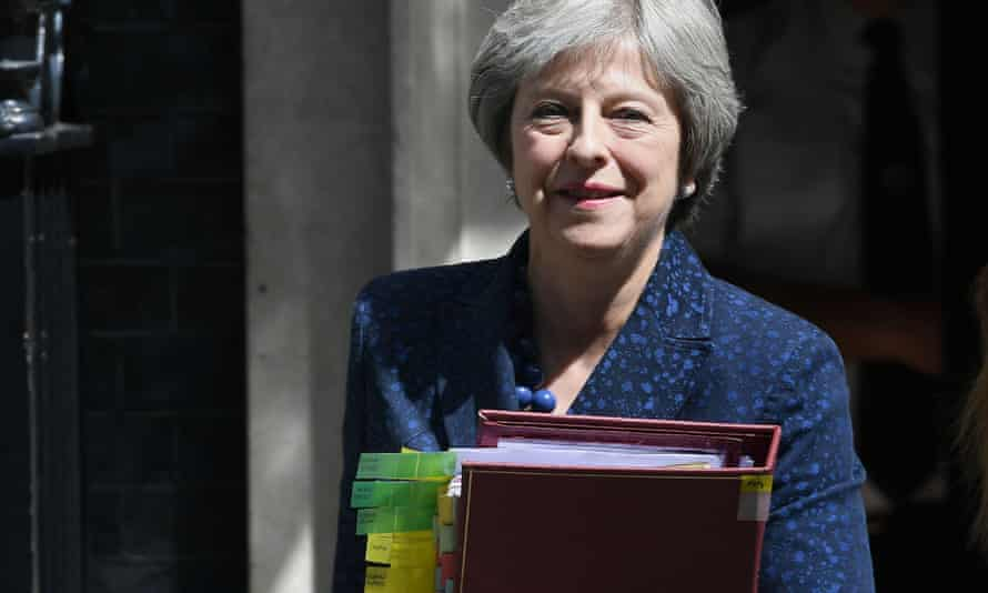Theresa May leaves 10 Downing Street for the House of Commons