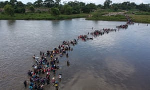 Salvadoran migrants heading in a caravan to the US, crossing the Suchiate river to Mexico from Guatemala, on 2 November.