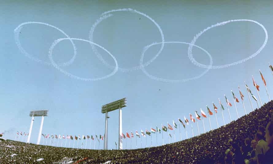 Blue Impulse, the Japanese air force's aerobatic team, draw Olympic rings in the sky during the 1964 opening ceremony.