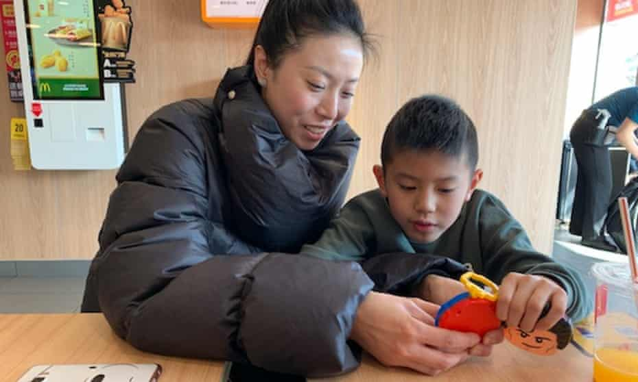 Xu Meiru with her son at McDonald's