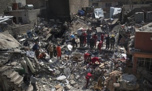 Civilian rescue teams work on debris from a destroyed house in Mosul.