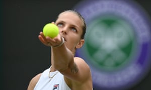 Czech Republic's Karolina Pliskova serves against Switzerland's Viktorija Golubic.
