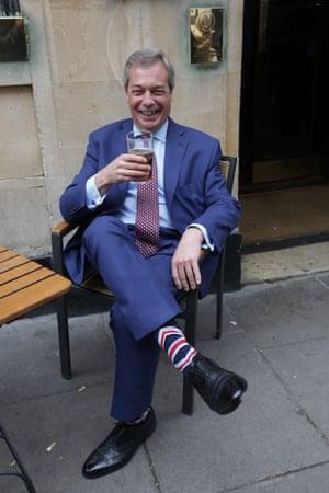 Nigel Farage wears Union Flag socks as he drinks in a pub in Westminster.