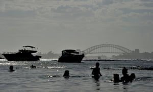 People enjoy the water at Milk Beach in Sydney