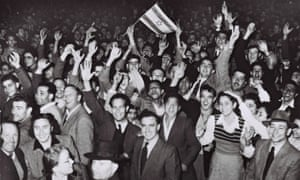 (FILE) Israel At 60: The Birth Of A NationTEL AVIV, PALESTINE - NOVEMBER 29, 1947: Jubilant residents celebrate with what would become the Israeli flag after the United Nations decision to approve the partition of Palestine November 29, 1947 as crowds gather in front of the Mugrabi cinema in Tel Aviv in the British Mandate for Palestine. (Photo by Hans Pins/GPO via Getty Images) ""