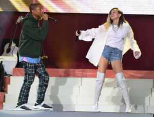 US musicians Pharrell Williams (L) and Miley Cyrus perform at the One Love Manchester benefit concert