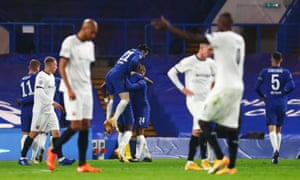 Chelsea celebrate Tammy Abraham's goal as Rennes players argue among themselves.
