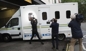 A van believed to be carrying Thomas Mair arrives under police escort at Westminster magistrates court.