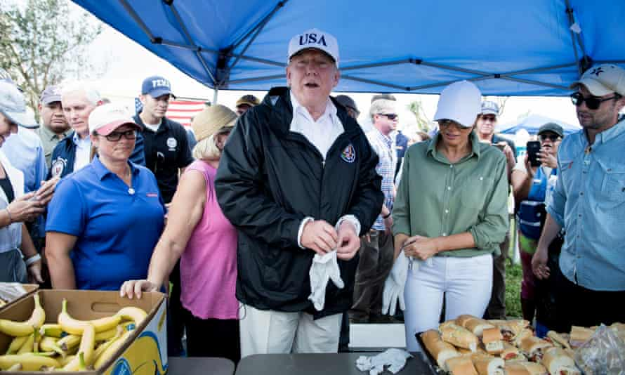 Donald and Melania Trump hand out food in Naples, Florida, on 14 September. The hurricane was the largest storm in more than a decade to hit the US.