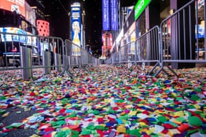 Fallen confetti on an empty street in Times Square during the virtual New Year's Eve event in New York.