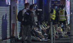 Police arrest anti-government protesters in Hong Kong early on Monday 11 May.
