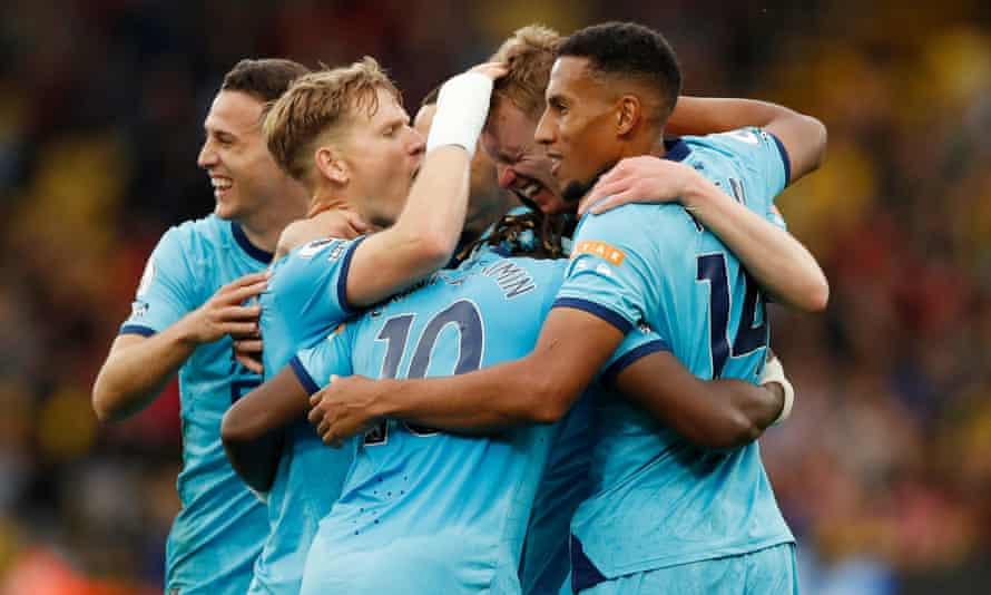 Newcastle players celebrate Sean Longstaff's opener.