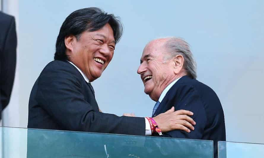 Costa Rica football president Eduardo Li shakes hands with Fifa president Sepp Blatter before kickoff at a 2014 World Cup match.