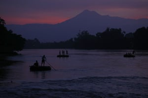 Rafts carry people and goods across the Suchiate river, between Tecun Uman, Guatemala, and Ciudad Hidalgo, Mexico.