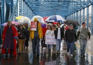 Demonstrators cross bridge