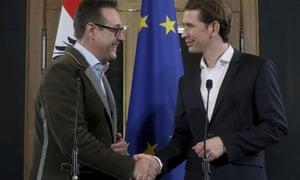 Heinz-Christian Strache, left, shakes on the deal with Sebastian Kurz in Vienna, Austria, on Friday.