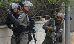 Israeli troops take position as they clash with Palestinian youth near Ramallah in the occupied West Bank.