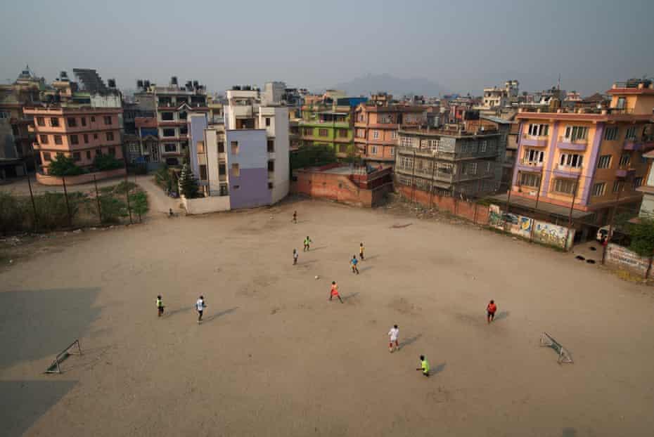 West African footballers practise at a ground in Naya Bazaar, in central Kathmandu