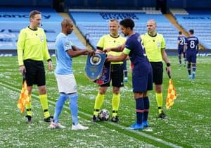 Fernandinho of Manchester City and Marquinhos of Paris Saint-Germain swap pennants prior to their UEFA Champions League Semi Final.