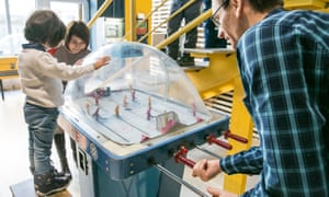 Visitors play a table ice-hockey game at the Museum of Soviet Arcade Machines, St Petersburg, Russia.