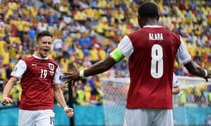 Christoph Baumgartner of Austria celebrates with David Alaba after opening the scoring.