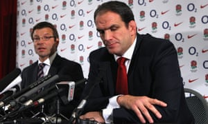 Andrew, left, sits alongside Martin Johnson as he announces his resignation as the England head coach in November 2011 at Twickenham.