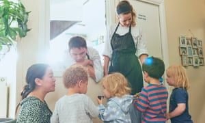 Head chef Elena Coates and sous chef Liam Hughes, of charity Chefs in Schools, show children lunch ingredients at the Little Jungle nursery in East Dulwich, London.