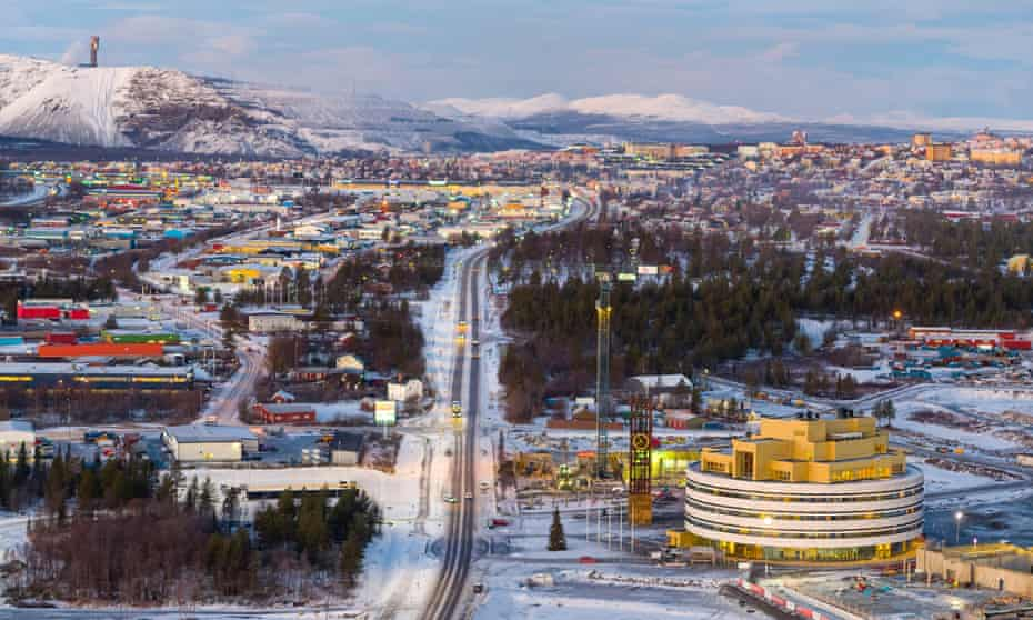 Kiruna's new City Hall, lower right, by Henning Larsen architects, sits about 3km from the world's biggest iron mine, top left.