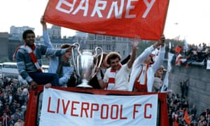 Gayle and Alan Kennedy hold the European Cup during an open-top bus parade through Liverpool in May 1981, and shortly after Bob Paisley's side had won the trophy for a third time in Paris