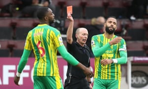 Semi Ajayi is shown a red card by referee Mike Dean.