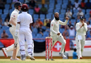 Moeen Ali celebrates taking the wicket of Shane Dowrich.