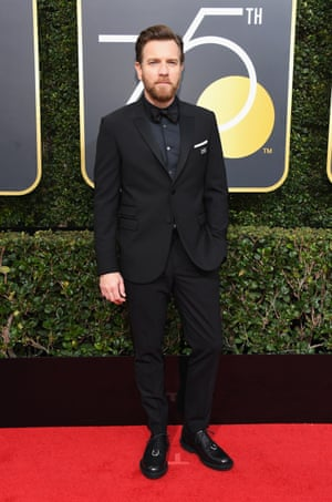 Ewan McGregor, star of Fargo, arrives wearing all black and the #TimesUpNow badge.