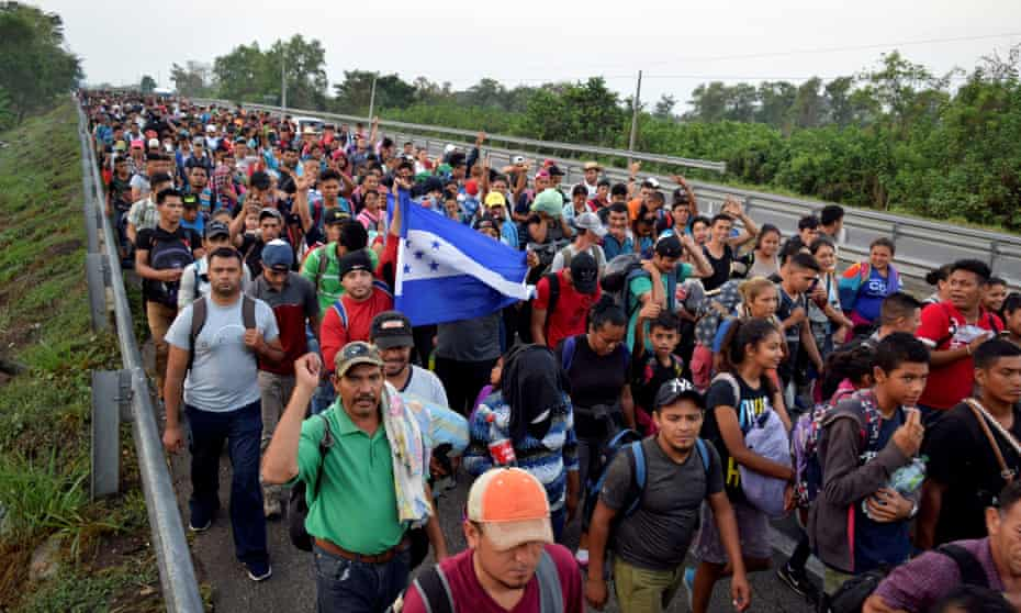 Migrants from Central America and Cuba walk on a highway during their journey towards the United States, in Tuzantan, in Chiapas state, on Monday.