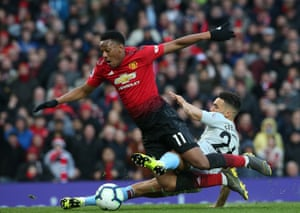 Manchester United's Anthony Martial is scythed down by West Ham's Ryan Fredericks and the second penalty is awarded.