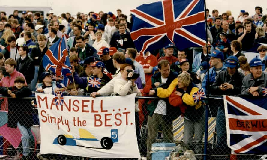 Fans celebrate Nigel Mansell's victory in the British Grand Prix in July 1992 - a month later he was world champion