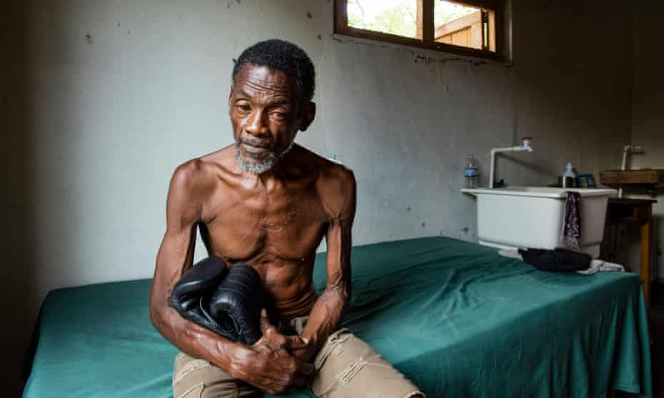 Vernon Vanriel in the roadside shack where he lives without electricity or a bathroom.