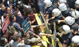 Protestors confront police during a demonstration in Istanbul against the controversial demolition of the city's historic Emek Cinema in 2013.