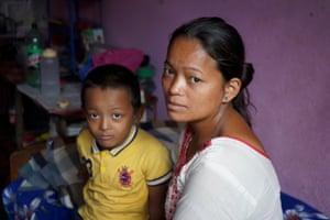 Rumba's wife Nirmala Pakrin, 26, and son,  Nirmal, 6.