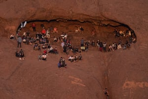 Phoenix, US. Hikers watch the sunset from Hole-in-the-Rock at Papago park