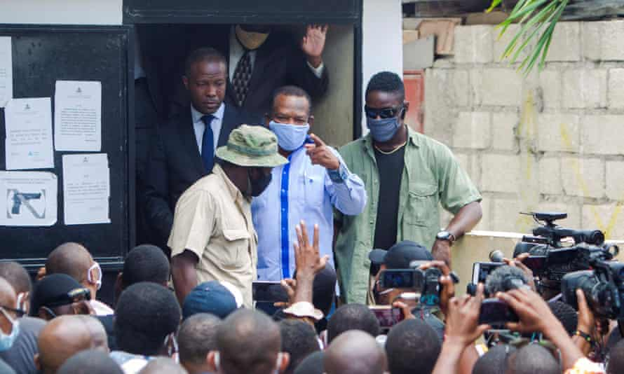 Yves Jean Bart leaves the prosecutor's office in Port-au-Prince, Haiti, during an investigation into the sexual abuse allegations made against him.