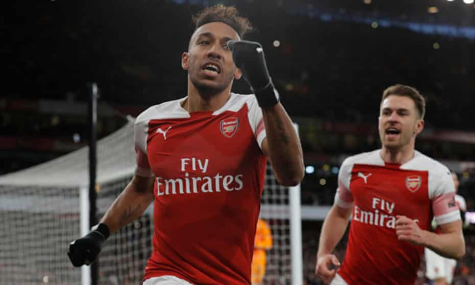 Pierre-Emerick Aubameyang celebrates sealing victory for Arsenal from the penalty spot against Manchester United.