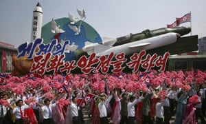 North Koreans with missile models