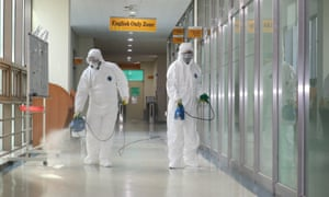Quarantine officials disinfecting a dormitory for Chinese students at Chosun University in Gwangju, South Korea.
