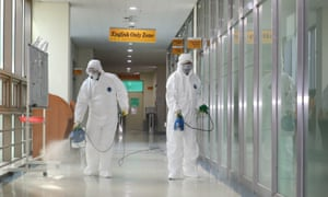 Officials disinfecting a dormitory for Chinese students at Chosun University in Gwangju, South Korea.