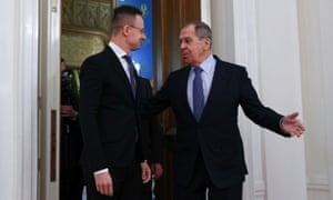 Russian Foreign Minister Sergei Lavrov shows Hungarian Foreign Minister Peter Szijjártó the way during a meeting in Moscow on Friday.