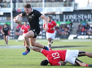 New Zealand's George Bridge scores a try against Tonga.