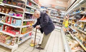 Elderly man shopping in a Tesco Express supermarket, London