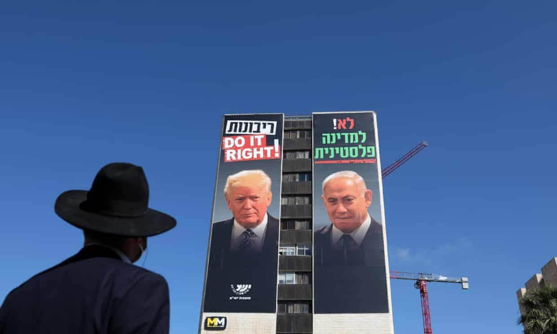 a billboard showing Israeli Prime Minister Benjamin Netanyahu (R) and US President Donald Trump (L)