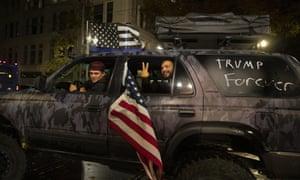 Supporters of President Donald Trump drive Saturday, Nov. 7, 2020, in Portland, Ore.